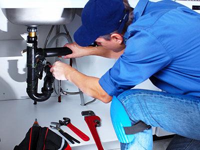 Plumber Fixing Faucet Drain