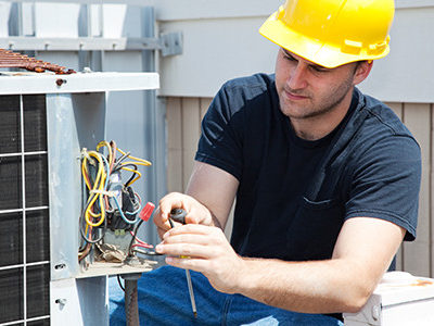 HVAC Specialist fixing the airconditioning unit