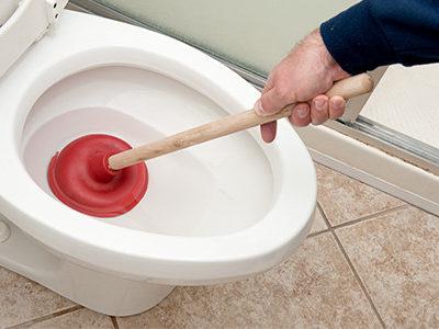 Toilet Repair Man Uses Plunger