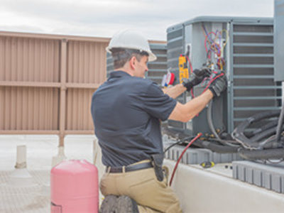 Technician-checking-condenser