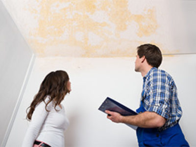 Woman-and-technician-discussing-water-stain