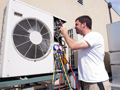 HVAC-being-worked-on-technician